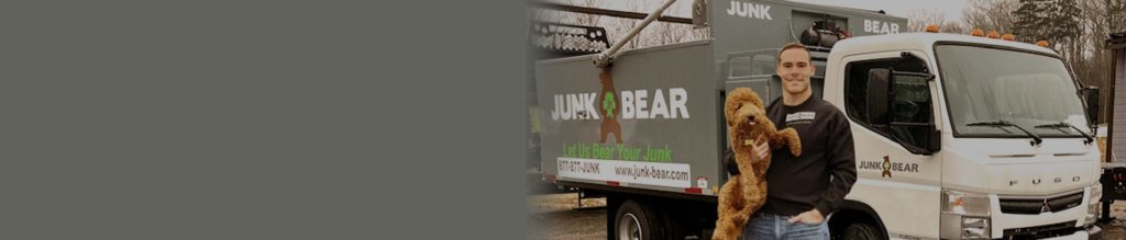 Junk removal professional with a junk removal truck