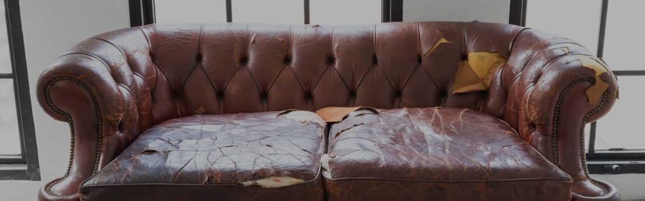 Old couch in need of furniture removal services