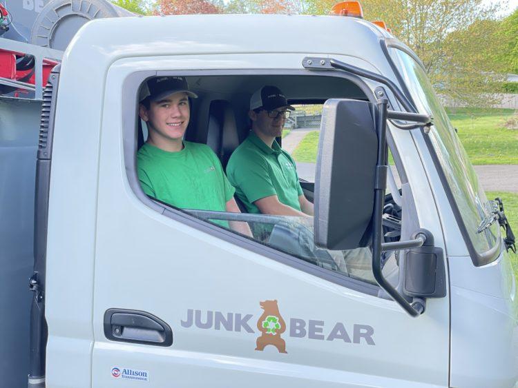 Junk Bear team members in truck