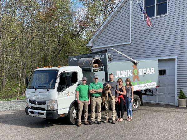 Junk Bear team members in front of truck