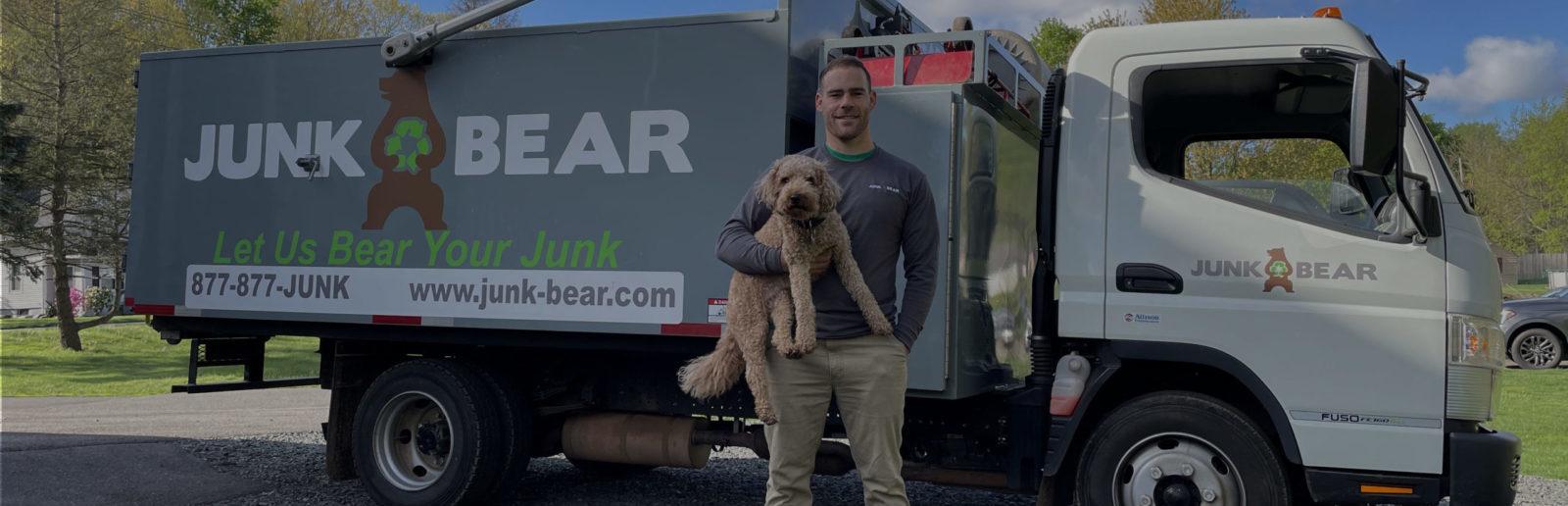 Junk Bear team member with dog