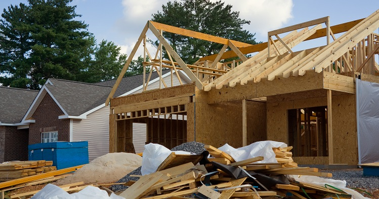 Piles of construction debris in need of construction debris removal services