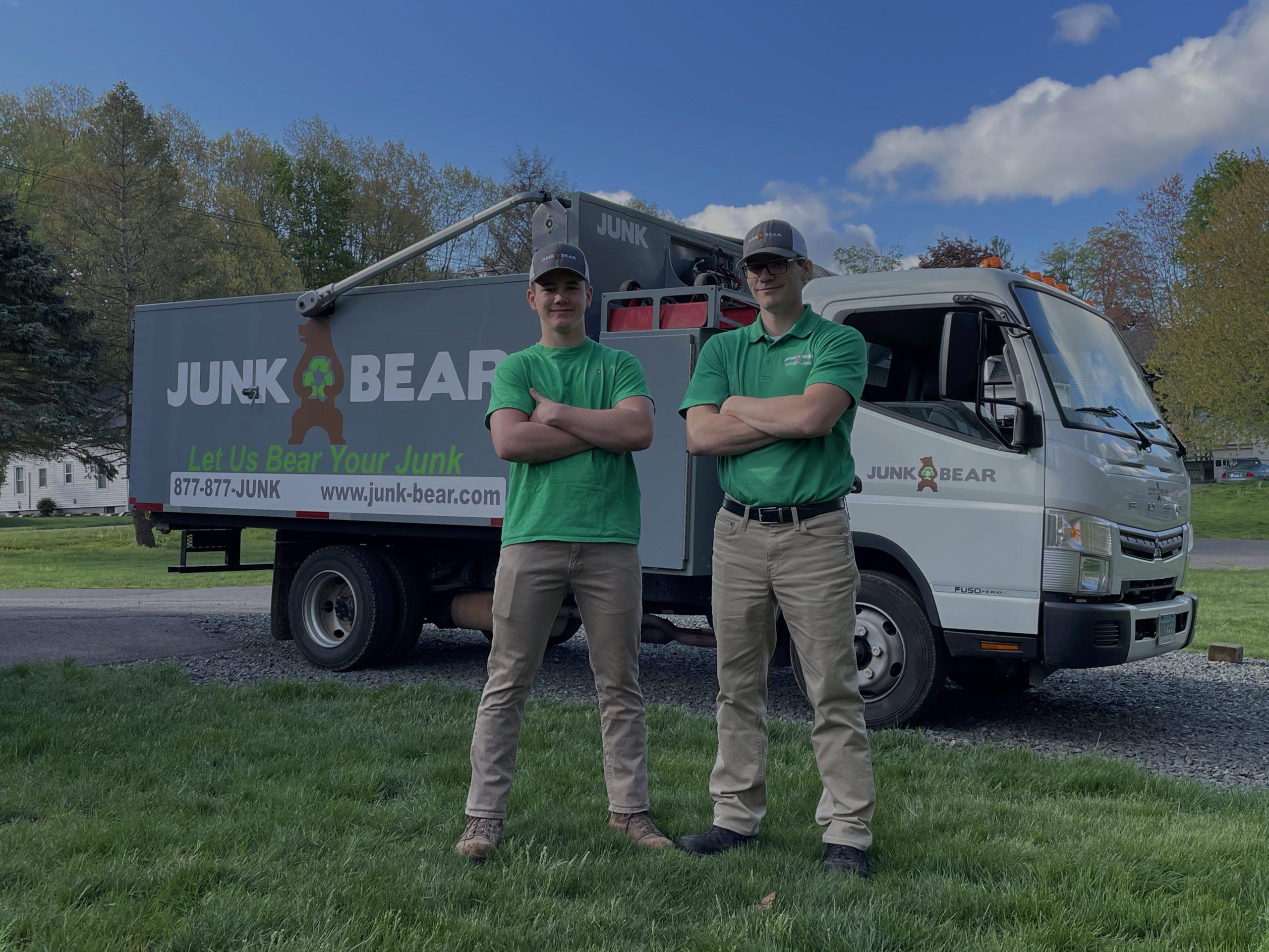 Junk Bear team members smiling in front of junk trunk