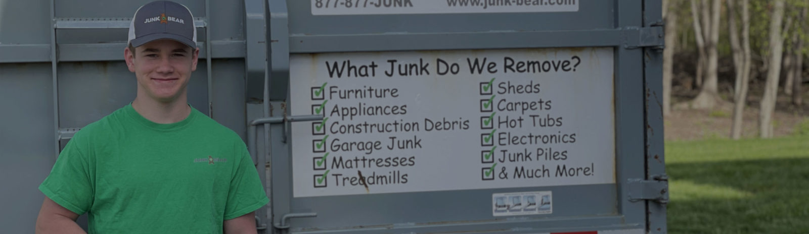 Junk Bear team member with what do we remove sign