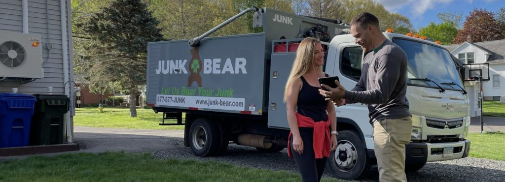 New Haven junk removal professional interacting with a customer