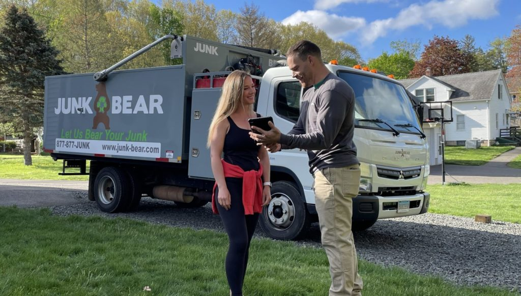 Professional for Hartford, CT junk removal interacting with a customer